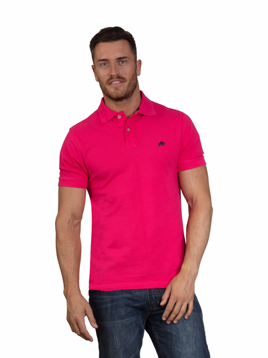 model wearing vivid pink polo shirt