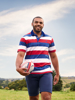 model wearing high quality red white and blue striped short sleeve rugby shirt