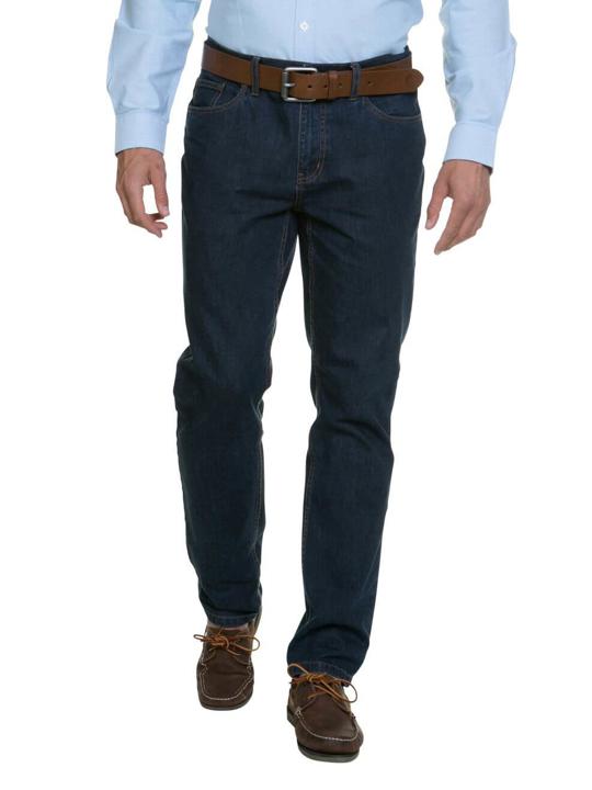model wearing high quality dark denim tapered jeans